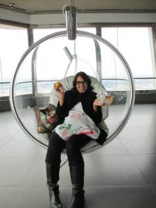 The wonderful, vibrant Ruchika at the top of The Žižkov Television Tower having a snack in Prague, Czech Republic.