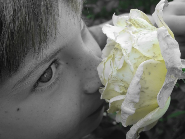 My Nephew smelling a rose on a recent trip to the Portland Rose Garden.